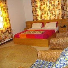 Апартаменты Calabash Green Executive Apartments Тема комната для гостей фото 2