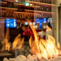 Отель Dorint Airport-Hotel Zürich Швейцария, Глаттбруг - отзывы, цены и фото номеров - забронировать отель Dorint Airport-Hotel Zürich онлайн гостиничный бар