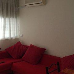 Отель Tirana Apartment Албания, Тирана - отзывы, цены и фото номеров - забронировать отель Tirana Apartment онлайн комната для гостей фото 3