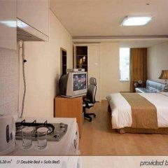 Отель Hyundai Residence Seoul сейф в номере