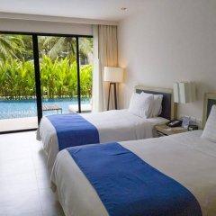 Отель Holiday Inn Resort Phuket Mai Khao Beach пляж Май Кхао комната для гостей фото 3