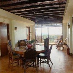 Отель MC Mountain Home Apartelle Филиппины, Тагайтай - отзывы, цены и фото номеров - забронировать отель MC Mountain Home Apartelle онлайн комната для гостей фото 3
