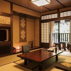 Отель Sanga Ryokan Минамиогуни комната для гостей фото 3