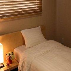 An Guesthouse For Female Only (гостевой дом для женщин) комната для гостей фото 2