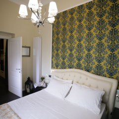 Апартаменты Agamennone Apartment Сиракуза комната для гостей фото 4