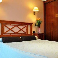Отель Puerta Del Oriente Испания, Льянес - отзывы, цены и фото номеров - забронировать отель Puerta Del Oriente онлайн комната для гостей