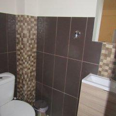 Отель Nota Hotel Apartments Греция, Афины - отзывы, цены и фото номеров - забронировать отель Nota Hotel Apartments онлайн ванная