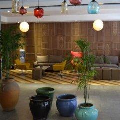Отель Sotel Inn Cultura Hotel Zhongshan Branch Китай, Чжуншань - отзывы, цены и фото номеров - забронировать отель Sotel Inn Cultura Hotel Zhongshan Branch онлайн интерьер отеля