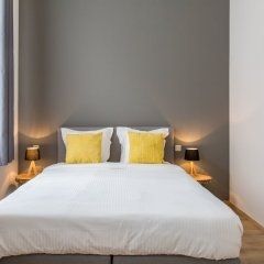 Отель Urban Suites Brussels Schuman Брюссель комната для гостей