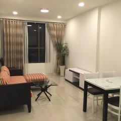 Апартаменты Lehome Serviced Apartment Хошимин комната для гостей