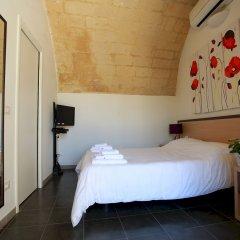 Отель Per Le Vie Del Magico Mosto Матера комната для гостей