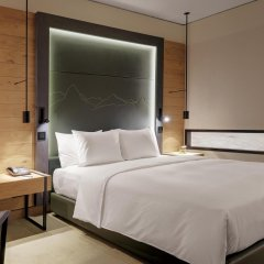 Отель Hilton Munich Airport Германия, Мюнхен - 7 отзывов об отеле, цены и фото номеров - забронировать отель Hilton Munich Airport онлайн комната для гостей фото 4