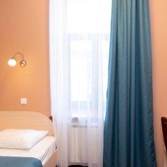Апартаменты Гостевые комнаты и апартаменты Грифон комната для гостей фото 2