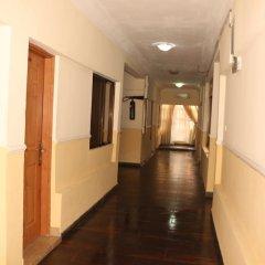 Отель Xcape Hotels and Suites Ltd Нигерия, Калабар - отзывы, цены и фото номеров - забронировать отель Xcape Hotels and Suites Ltd онлайн интерьер отеля фото 3