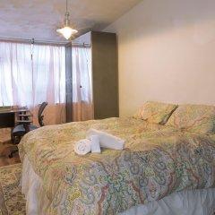 Отель NY072 2 Bedroom Apartment By Senstay США, Нью-Йорк - отзывы, цены и фото номеров - забронировать отель NY072 2 Bedroom Apartment By Senstay онлайн комната для гостей фото 5