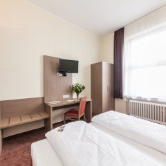 Отель Maxim Novum Дюссельдорф комната для гостей фото 3