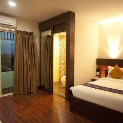 Отель Suvarnabhumi Suite Бангкок комната для гостей фото 3
