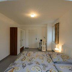 Отель NAAM Apartments Frankfurt Griesheim Германия, Франкфурт-на-Майне - отзывы, цены и фото номеров - забронировать отель NAAM Apartments Frankfurt Griesheim онлайн комната для гостей фото 3