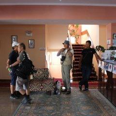 Отель Tagaitai Guest House Кыргызстан, Каракол - отзывы, цены и фото номеров - забронировать отель Tagaitai Guest House онлайн интерьер отеля