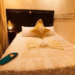 Отель Dar Ikalimo Marrakech комната для гостей фото 4
