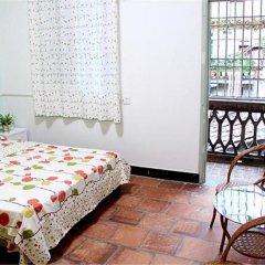 Отель Xiamen Qinchunyuan Holiday Villa Китай, Сямынь - отзывы, цены и фото номеров - забронировать отель Xiamen Qinchunyuan Holiday Villa онлайн балкон