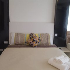 Отель City Center Residence by Pattaya Holiday Паттайя комната для гостей фото 2