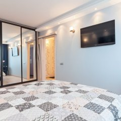 Апартаменты 4You Piter OnE Apartments Санкт-Петербург комната для гостей