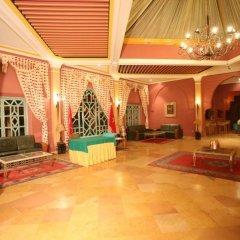 Отель Karam Palace Марокко, Уарзазат - отзывы, цены и фото номеров - забронировать отель Karam Palace онлайн интерьер отеля фото 2
