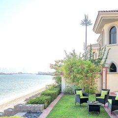 Отель Dream Inn Dubai-Luxury Palm Beach Villa пляж фото 2