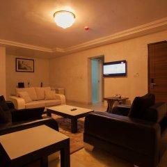 Отель Caledonian Suites комната для гостей