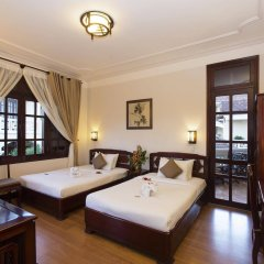 Lotus Hoi An Boutique Hotel & Spa Хойан комната для гостей фото 5