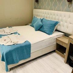 Отель Alright Suites сейф в номере