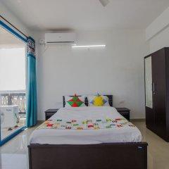 Отель OYO 11897 Home Greek Style 2BHK With Pool Bambolim Гоа комната для гостей