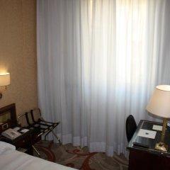 Отель UNAHOTELS Scandinavia Milano сейф в номере