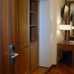 Отель Iris Генуя сейф в номере