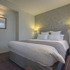 Отель Timhotel Opera Grands Magasins Париж комната для гостей фото 2