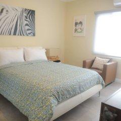 Апартаменты Lagoons Apartments комната для гостей