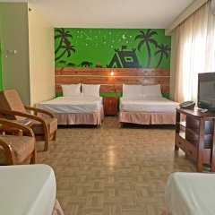 Отель Garden Villa Hotel США, Тамунинг - 2 отзыва об отеле, цены и фото номеров - забронировать отель Garden Villa Hotel онлайн комната для гостей фото 5