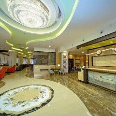 Отель Alain Hotel Apartments ОАЭ, Аджман - отзывы, цены и фото номеров - забронировать отель Alain Hotel Apartments онлайн интерьер отеля фото 2
