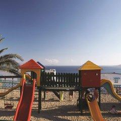 Отель Mitsis Family Village Beach Hotel Греция, Калимнос - отзывы, цены и фото номеров - забронировать отель Mitsis Family Village Beach Hotel онлайн приотельная территория