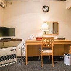 Petit Hotel Enchante Хакуба удобства в номере