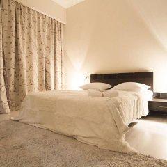 Отель Tbilisi Core: Aquarius Apartment Грузия, Тбилиси - отзывы, цены и фото номеров - забронировать отель Tbilisi Core: Aquarius Apartment онлайн комната для гостей фото 3