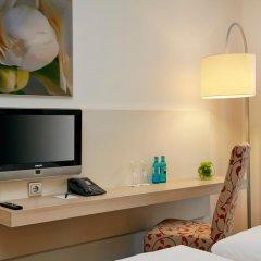 Отель H+ Hotel München Германия, Мюнхен - отзывы, цены и фото номеров - забронировать отель H+ Hotel München онлайн удобства в номере фото 2