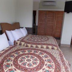 Отель Dharma Beach удобства в номере