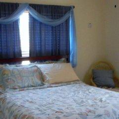 Отель The Residences At Briarwood Ямайка, Дискавери-Бей - отзывы, цены и фото номеров - забронировать отель The Residences At Briarwood онлайн комната для гостей фото 5
