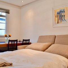 Апартаменты 2 Bedroom Apartment in Belsize Park Лондон комната для гостей фото 4