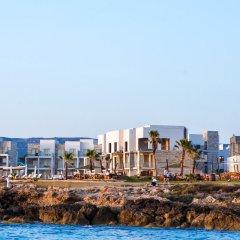 Amphora Hotel & Suites пляж фото 2