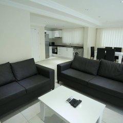Апартаменты Orka Royal Hills Apartment Олудениз комната для гостей