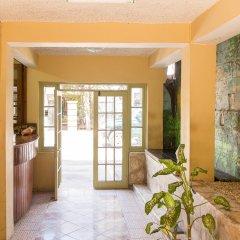 Отель Donway, A Jamaican Style Village Ямайка, Монтего-Бей - отзывы, цены и фото номеров - забронировать отель Donway, A Jamaican Style Village онлайн интерьер отеля фото 2