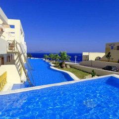 Отель Mitsis Family Village Beach Hotel Греция, Калимнос - отзывы, цены и фото номеров - забронировать отель Mitsis Family Village Beach Hotel онлайн бассейн фото 3
